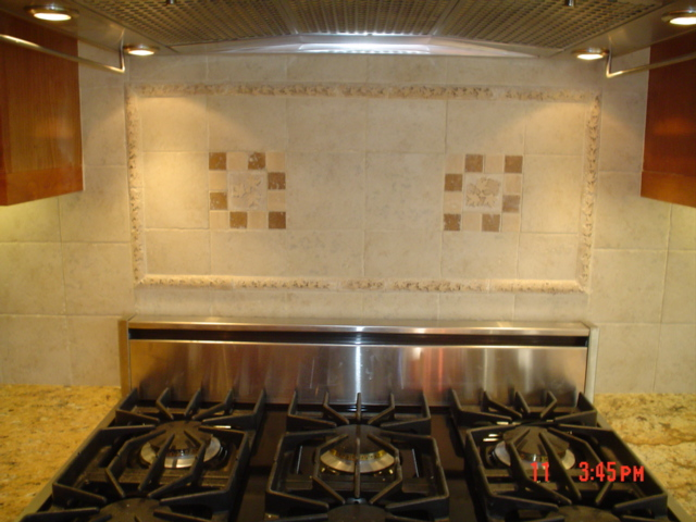 notice the nice, neat, cemetrical, clean tile job, plenty of lighting by the vent hood